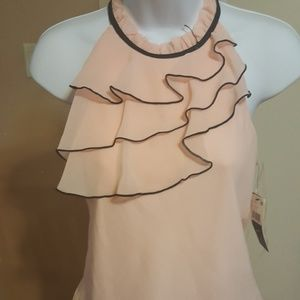 pink ruffled blouse w/ tie back and black piping